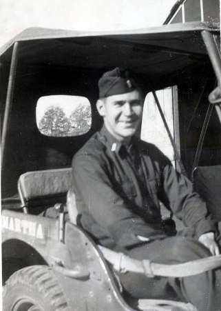1st Lt. Chas P. Macke in his Jeep